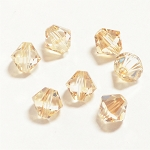 Crystal Golden Shadow 3mm Swarovski Xilion Bicone, Pkg. of 24