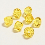 Light Topaz 6mm Swarovski Xilion Bicone, Pkg. of 12